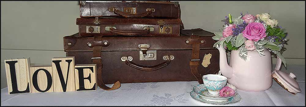 Signs, metal teapots, suitcases, Vintage China Hire Napier NZ