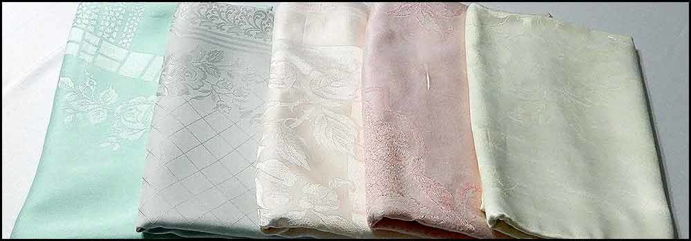 Vintage pastel coloured linen tablecloths available for hire at High Tea Hire